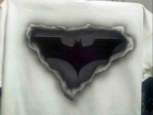 Airbrushed Batman Logo showing through ripped T shirt