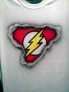 Airbrushed Flash Logo showing through ripped T shirt