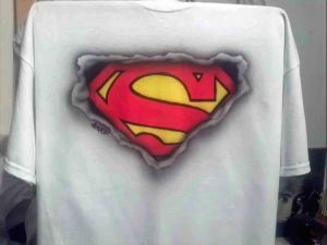 Airbrushed Superman Logo showing through ripped T shirt