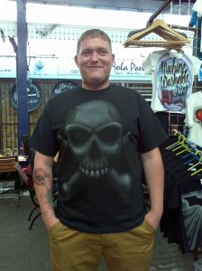 Robert weaing his Custom Airbrushed Skull & Bones T shirt